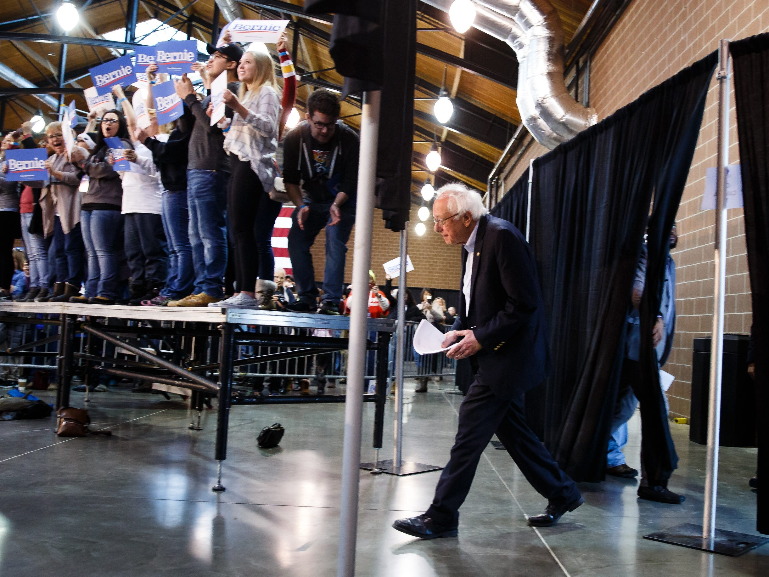 Democratic presidential candidate Bernie Sanders walks onto the stage before a rally at the Iowa State Fairgrounds on Saturday, March 9, 2019 in Des Moines.