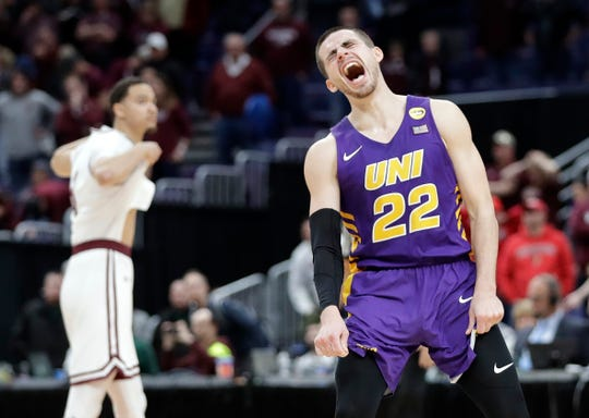 Northern Iowa's Wyatt Lohaus (22) celebrates at the final buzzer as Southern Illinois' Marcus Bartley is seen in background following an NCAA college basketball game in the quarterfinal round of the Missouri Valley Conference tournament, Friday, March 8, 2019, in St. Louis.