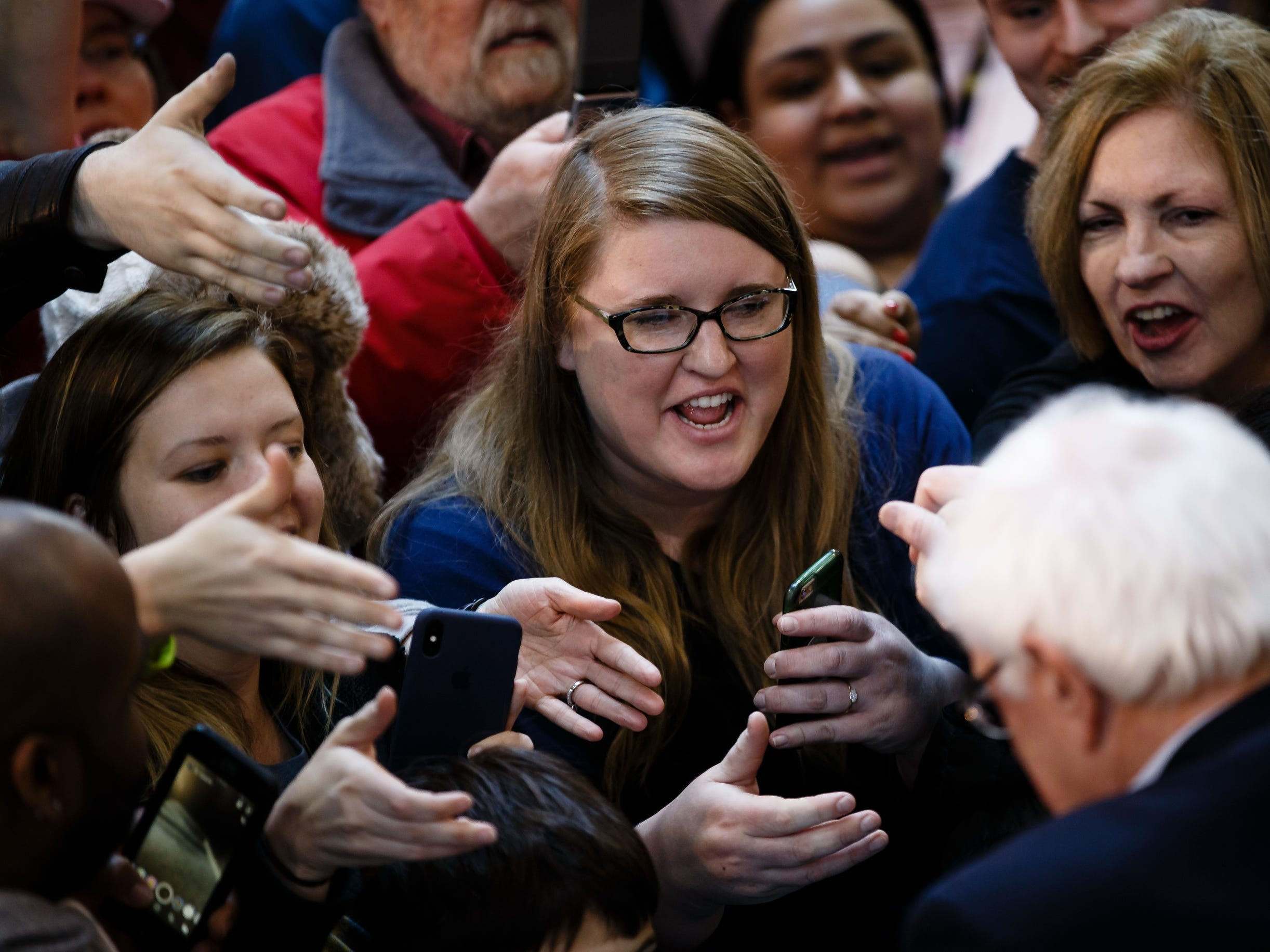 People wait for a chance to shake the hand of democratic presidential candidate Bernie Sanders during a rally at the Iowa State Fairgrounds on Saturday, March 9, 2019 in Des Moines.