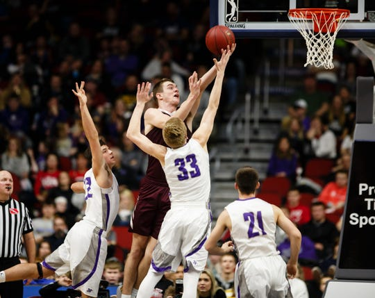 Oskaloosa's Cole Henry (40) shoots over Norwalk's Sam Rohrer (33) during their boys 3A state basketball championship game on Friday, March 8, 2019 in Des Moines. Oskaloosa would go on to defeat Norwalk 48-44 to win the 3A championship.