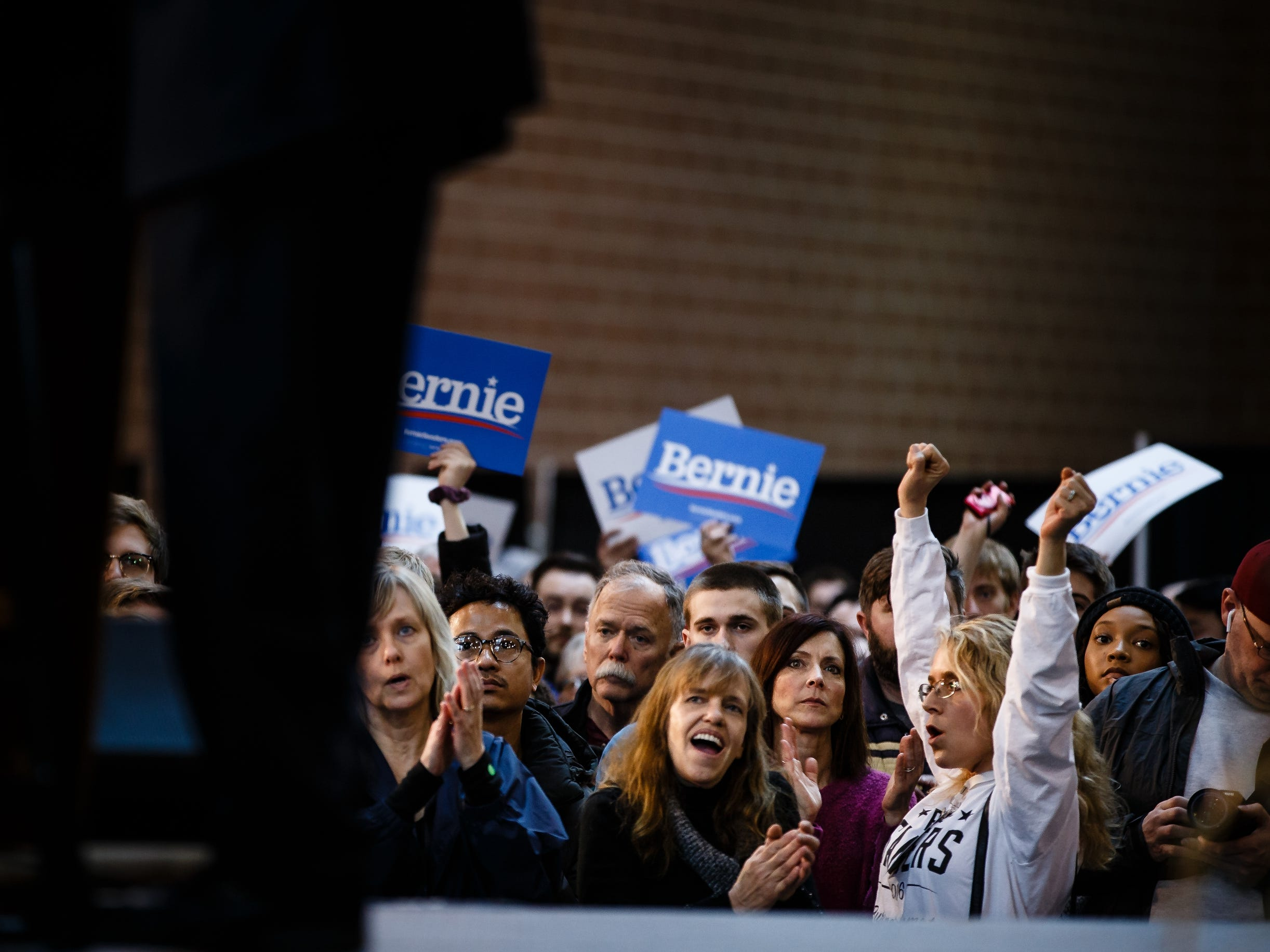 People cheer as Democratic presidential candidate Bernie Sanders speaks during a rally at the Iowa State Fairgrounds on Saturday, March 9, 2019 in Des Moines.