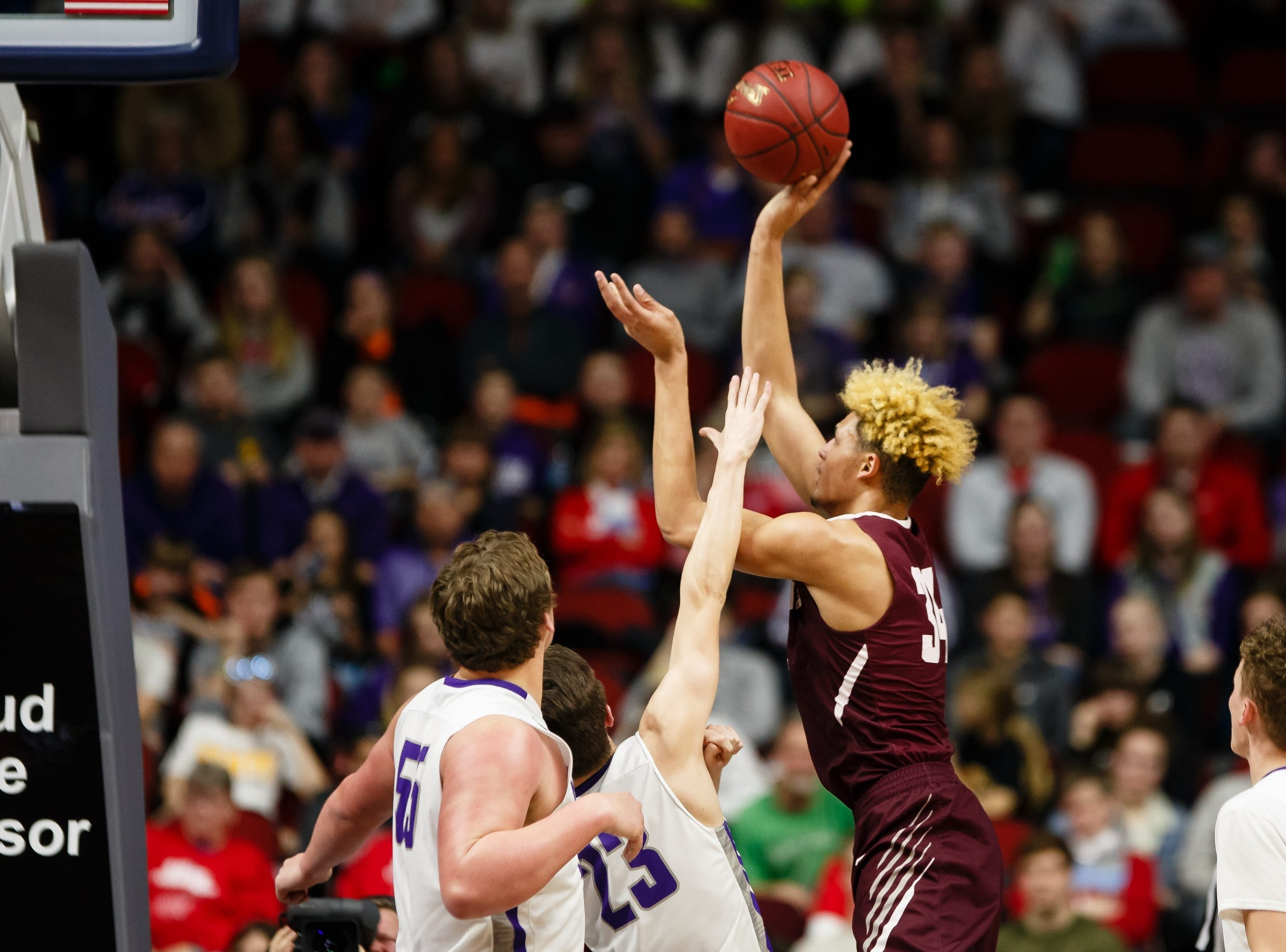 Oskaloosa's Xavier Foster (34) shoots during their boys 3A state basketball championship game on Friday, March 8, 2019 in Des Moines. Oskaloosa would go on to defeat Norwalk 48-44 to win the 3A championship.
