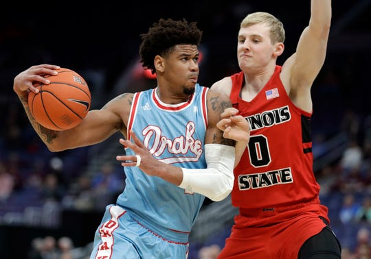 Drake's Tremell Murphy, left, heads to the basket past Illinois State's Isaac Gassman during the first half of an NCAA college basketball game in the quarterfinal round of the Missouri Valley Conference tournament, Friday, March 8, 2019, in St. Louis.