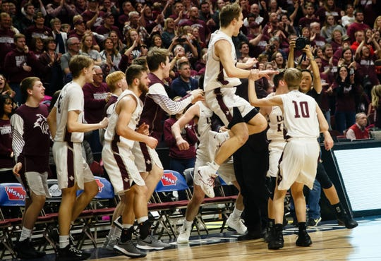 North Linn celebrates its 60-41 victory over Boyden-Hull during their boys 2A state basketball championship game on Friday, March 8, 2019 in Des Moines.