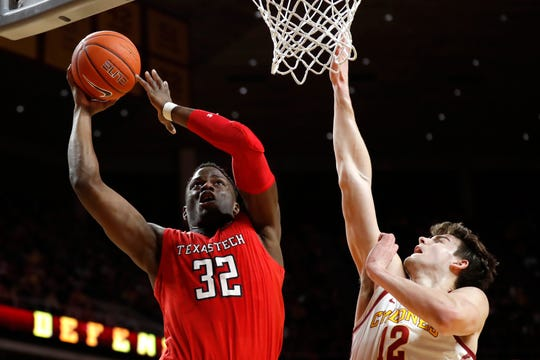 Texas Tech center Norense Odiase (32) drives to the basket over Iowa State forward Michael Jacobson during the first half of an NCAA college basketball game, Saturday, March 9, 2019, in Ames, Iowa.