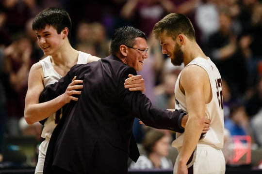 North Linn head coach Mike Hilmer hugs his players as they come to the bench during their boys 2A state basketball championship game on Friday, March 8, 2019 in Des Moines. North Linn would go on to defeat Boyden-Hull 60-41 and win the 2A championship.