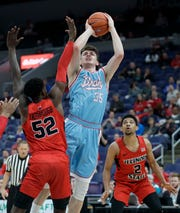 Drake's Nick McGlynn (35) shoots over Illinois State's Milik Yarbrough (52) and Zach Copeland (2) during the first half of the quarterfinal round of the Missouri Valley Conference tournament, Friday, March 8, 2019, in St. Louis.