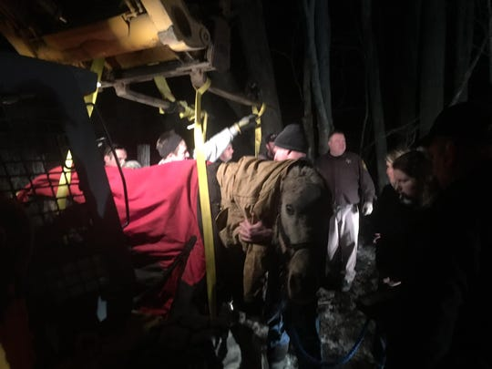Oxford firefighters and Oakland County Sheriff's Office deputies rescue a horse in Oxford on Friday, March 8, 2019.