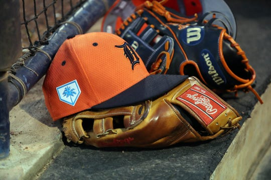 Detroit Tigers hat and glove lay in the dugout against the New York Yankees at George M. Steinbrenner Field on March 8, 2019.