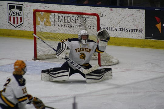 Trenton goalie Joey Cormier makes a glove save on Saturday during the Division 2 state championship game.