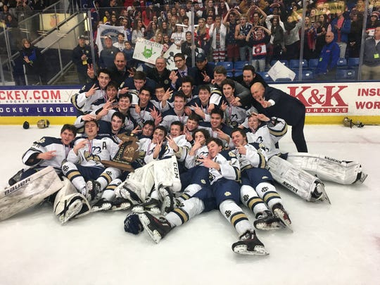 Birmingham Detroit Country Day celebrates after winning the MHSAA Division 3 state hockey championship on Saturday, March 9, 2019.