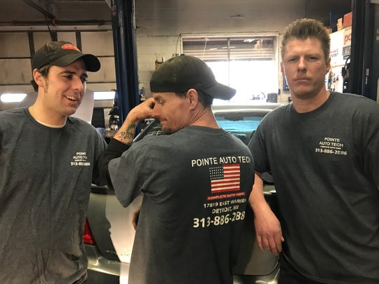From left, boss Mike Murphy, mechanic Kris Briscoe and mechanic Opie Shiver gather Friday inside Pointe Auto Tech in Detroit to talk about Sunday's Corktown Races.