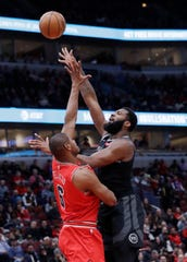 Detroit Pistons center Andre Drummond, right, shoots over Chicago Bulls forward/center Cristiano Felicio during the first half of an NBA basketball game Friday, March 8, 2019, in Chicago.