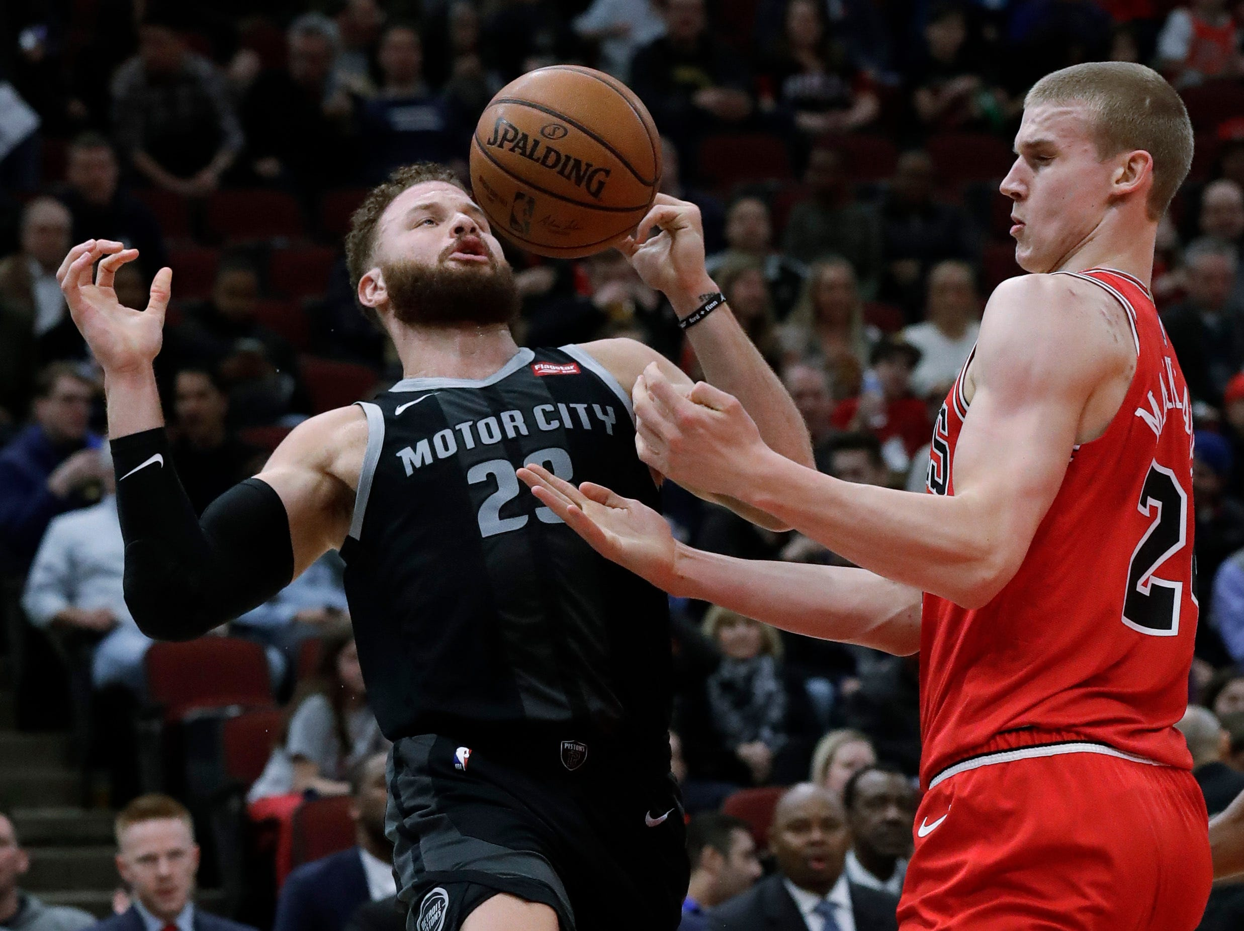 Detroit Pistons forward Blake Griffin, left, and Chicago Bulls forward Lauri Markkanen look to get possession of the ball during the first half of an NBA basketball game.
