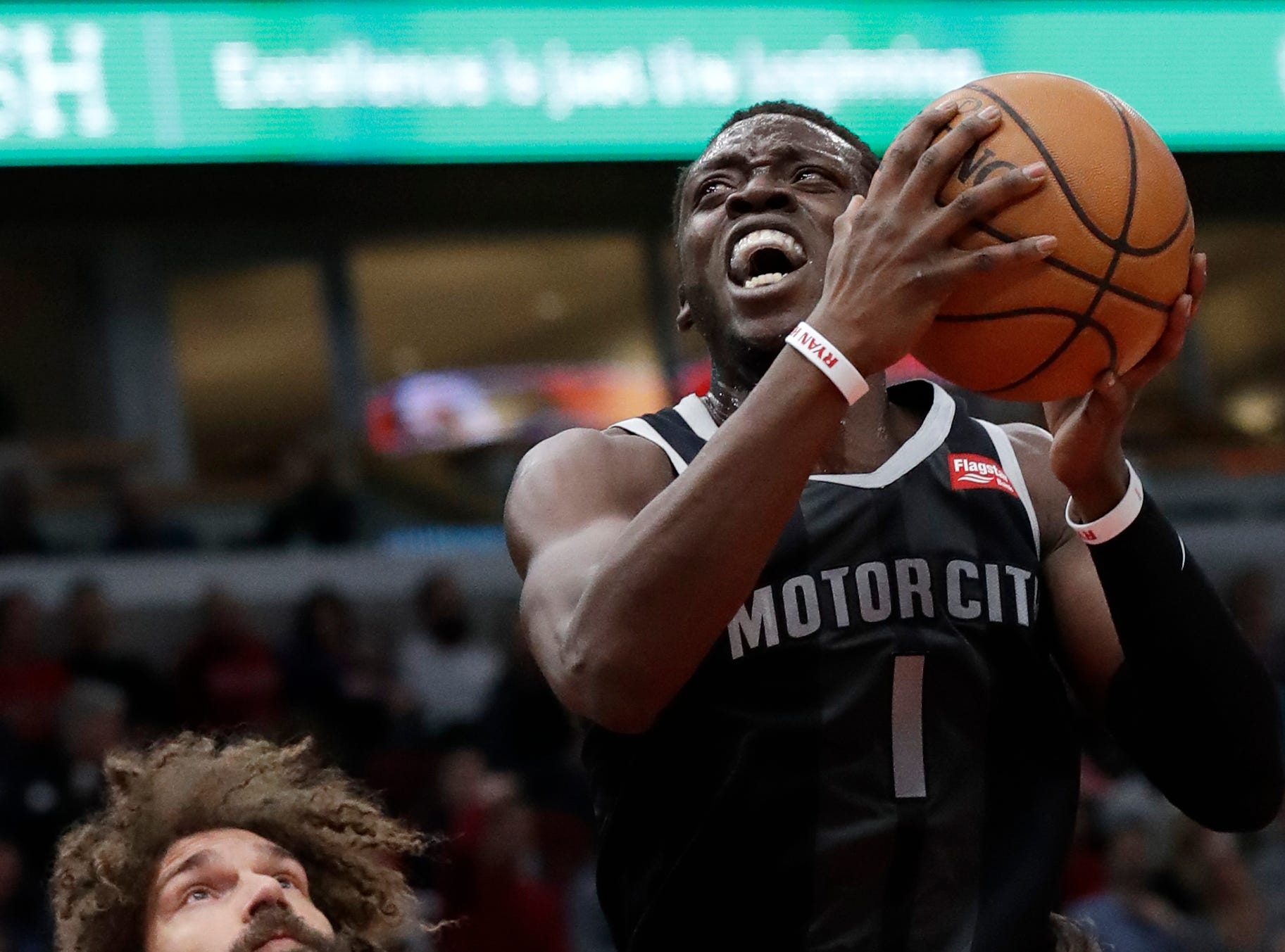 Detroit Pistons guard Reggie Jackson (1) drives to the basket against Chicago Bulls center Robin Lopez, left, and guard Ryan Arcidiacono during the first half of an NBA basketball game Friday, March 8, 2019, in Chicago.