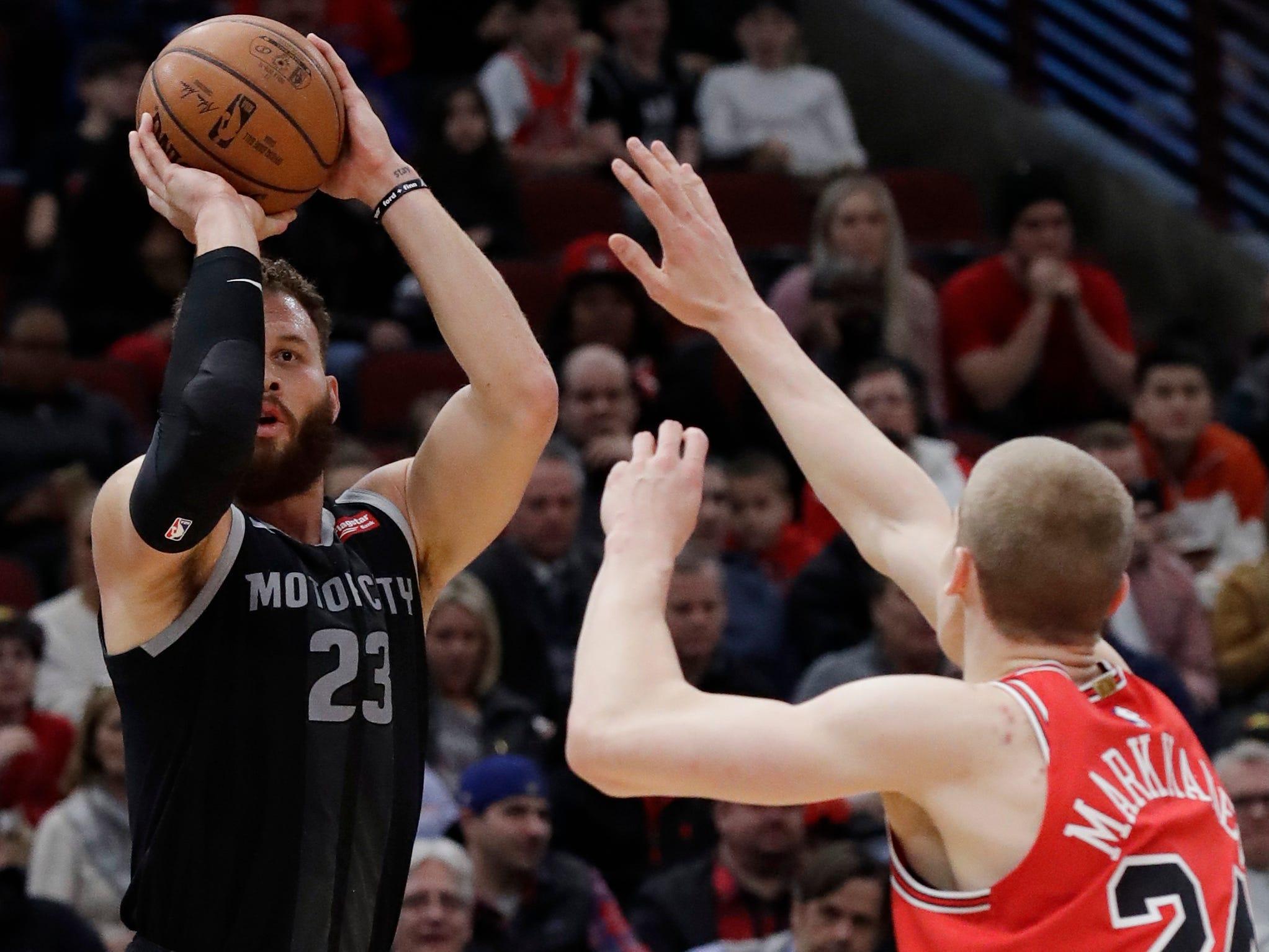 Detroit Pistons forward Blake Griffin, left, shoots against Chicago Bulls forward Lauri Markkanen during the first half.