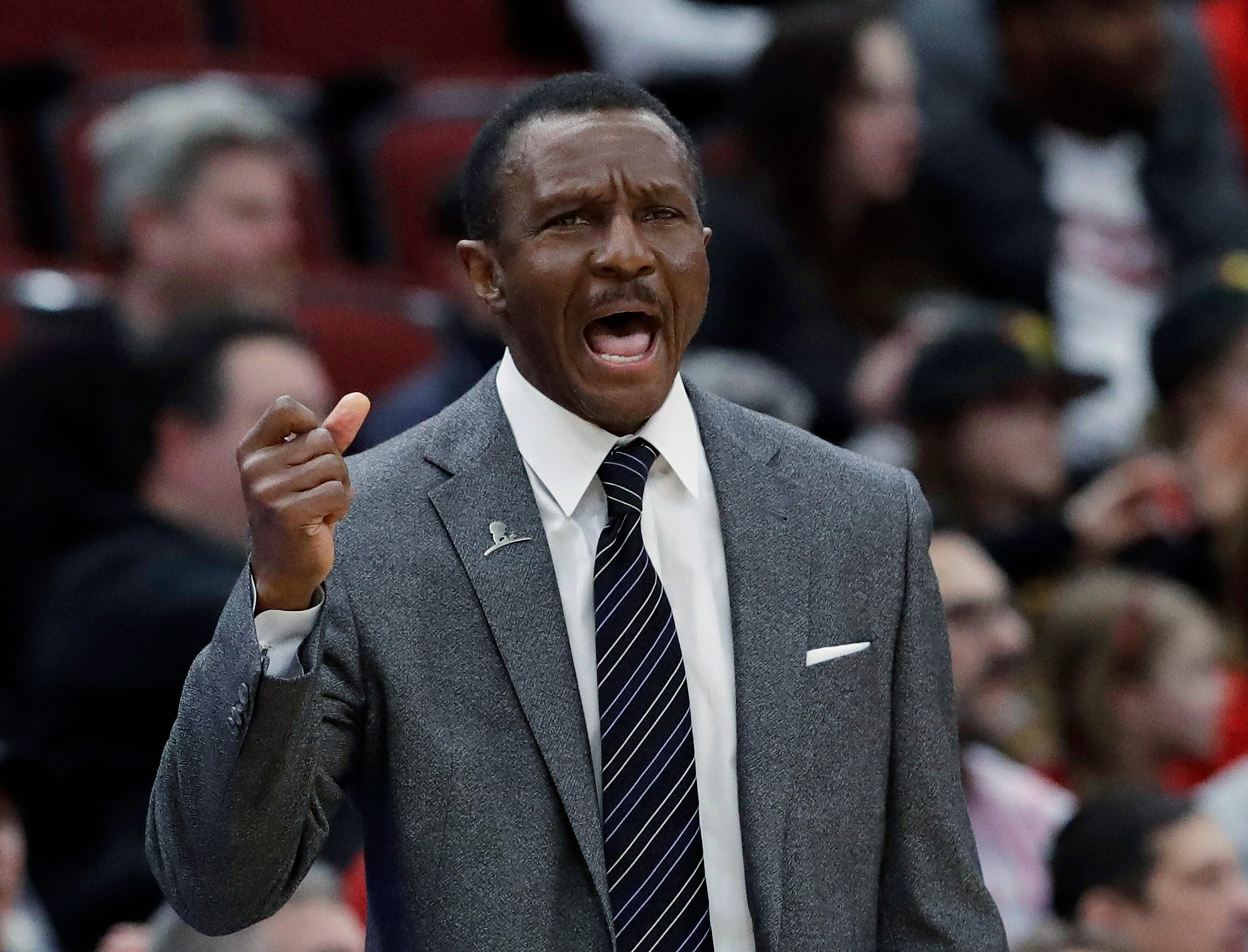 Detroit Pistons coach Dwane Casey shouts during the first half of the team's NBA basketball game against the Chicago Bulls.