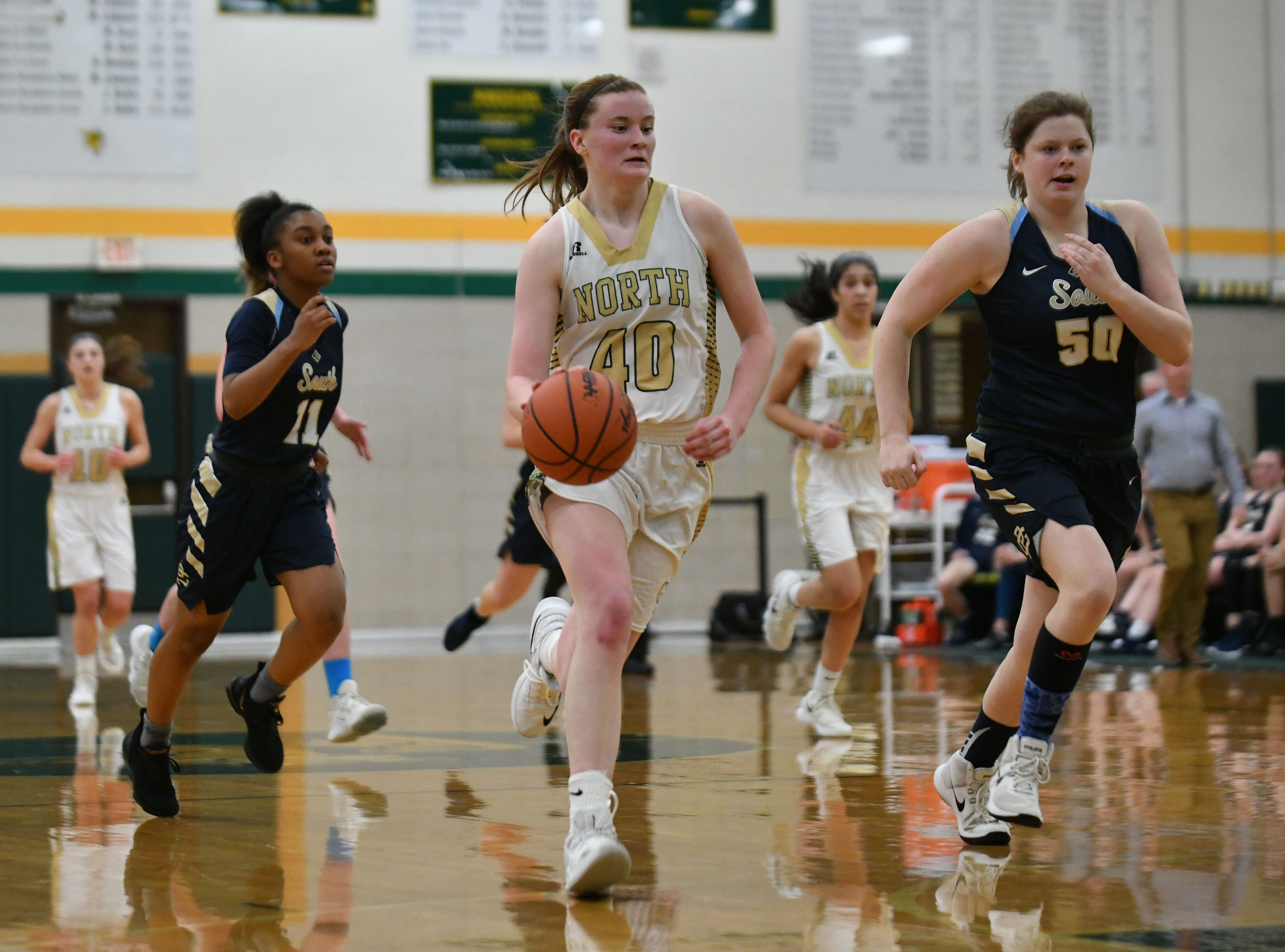 North senior Julia Ayrault dribbles up court in the second half.
