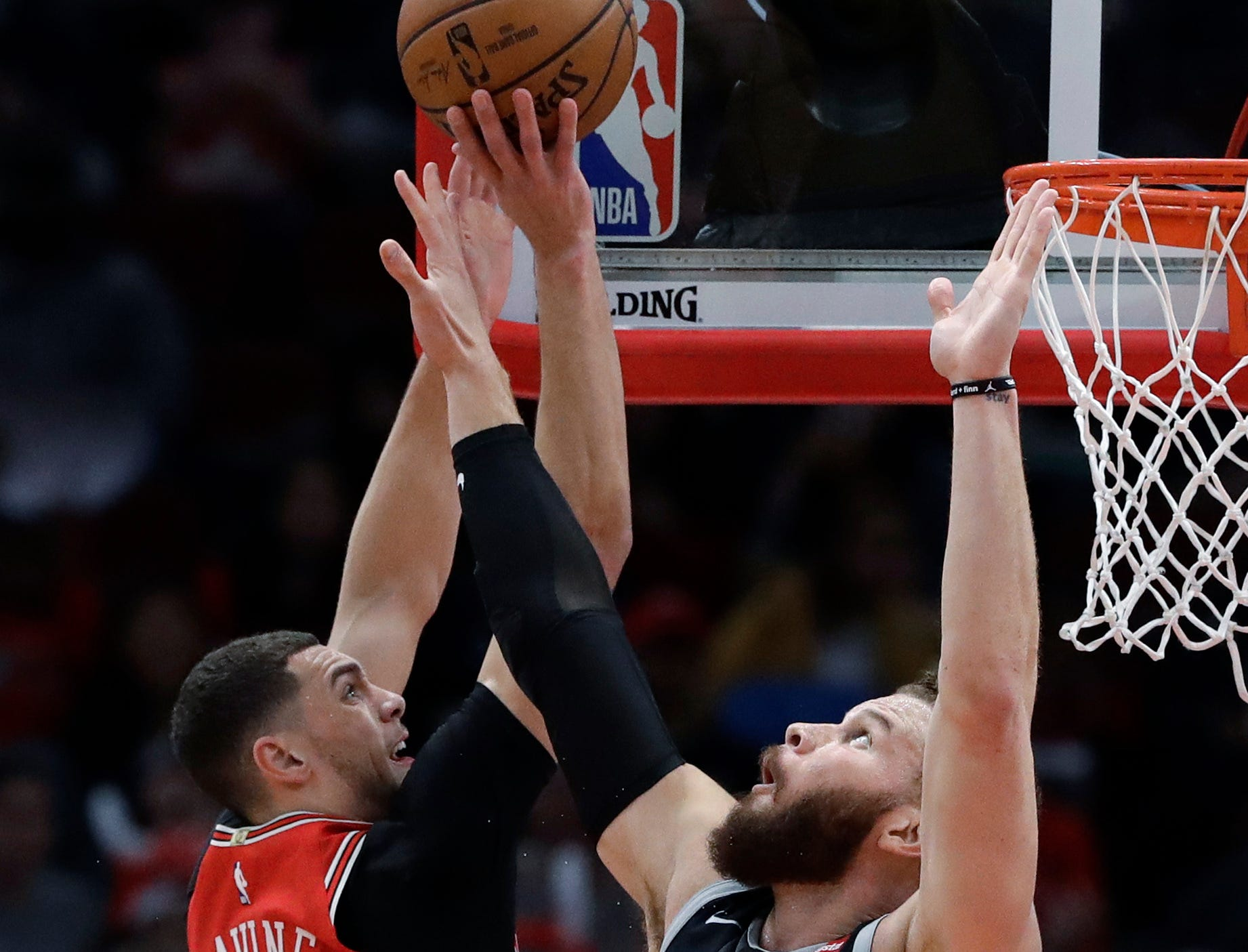 Chicago Bulls guard Zach LaVine, left, shoots against Detroit Pistons forward Blake Griffin during the first half of an NBA basketball game Friday, March 8, 2019, in Chicago.
