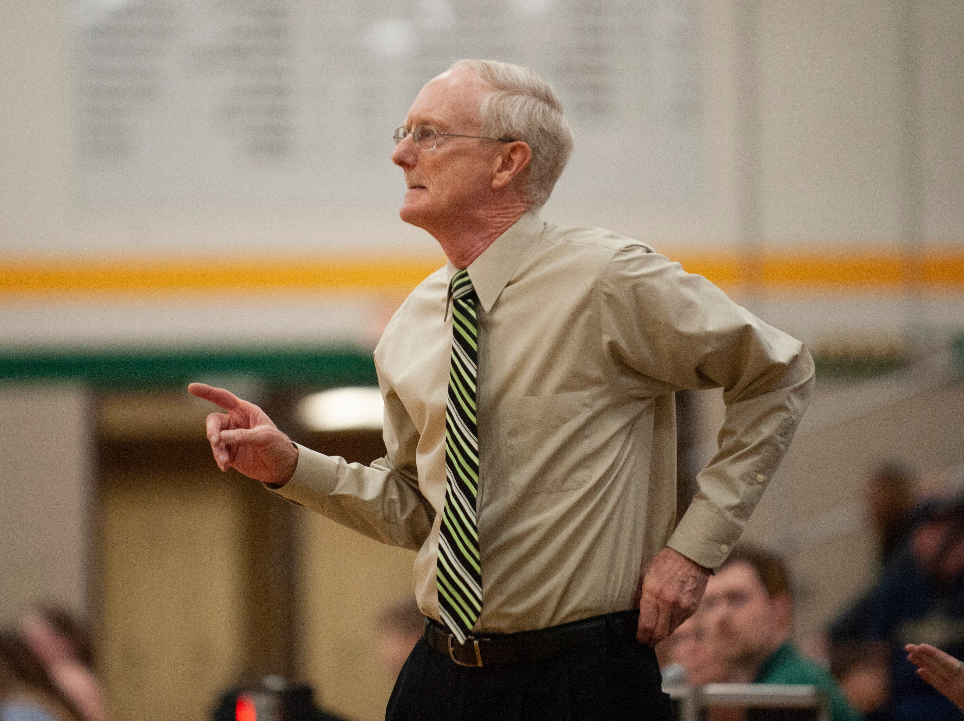 Grosse Pointe North head coach Gary Bennett directs the Norsemen in the first half.