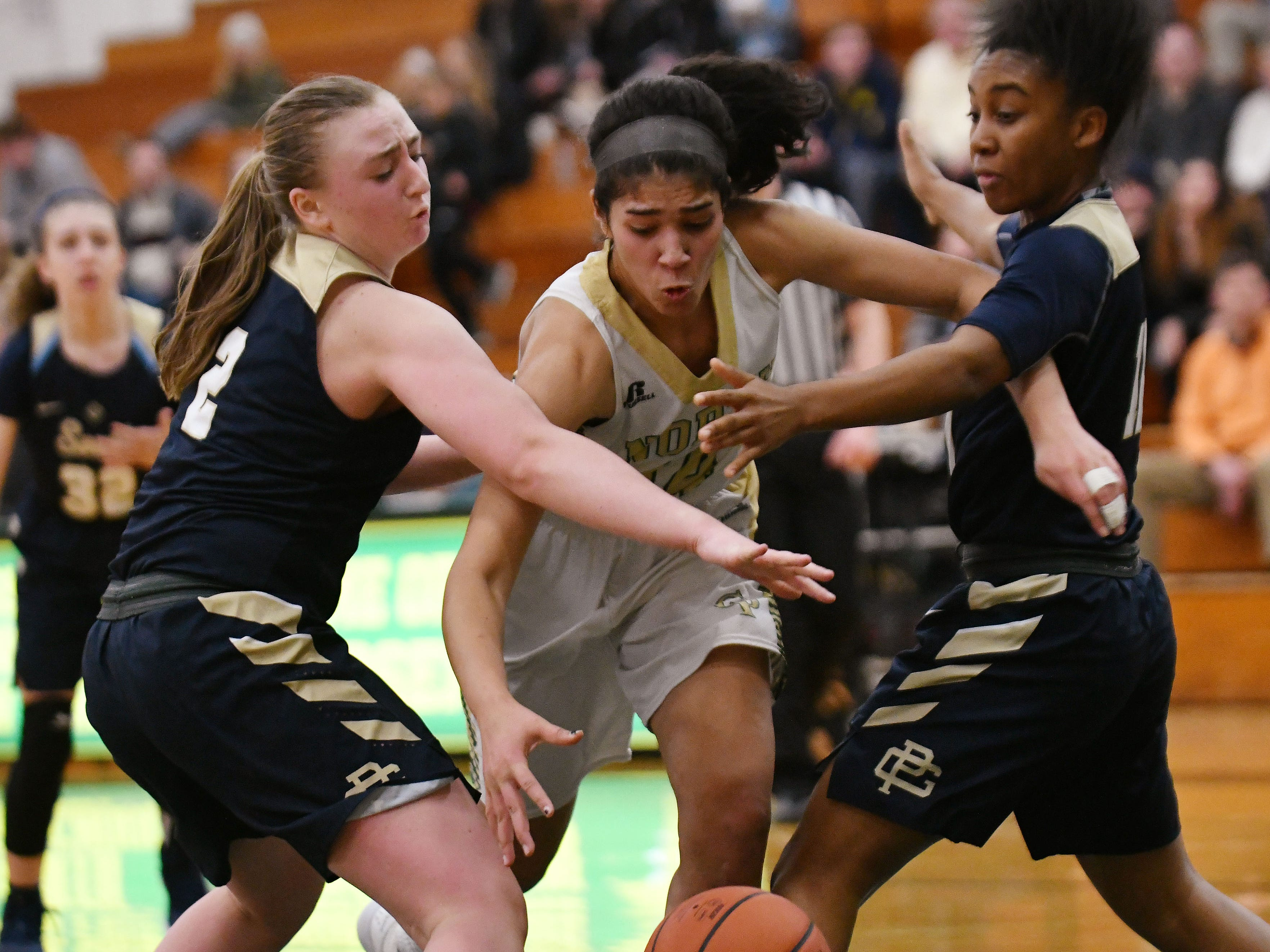 North's Christina Braker tries to split the South defense of Alexa Downey (left) and Sydni Hall during the second half.