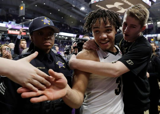 Purdue guard Carsen Edwards (3) celebrates with fans after Purdue defeated Northwestern 70-57 Saturday to clinch a share of the Big Ten regular-season title and the No. 2 seed in the conference tournament.