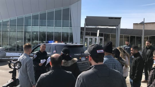 Troy Police Officer John Julian conducts a traffic stop and vehicle search with Walsh College students on Saturday at their Troy campus.