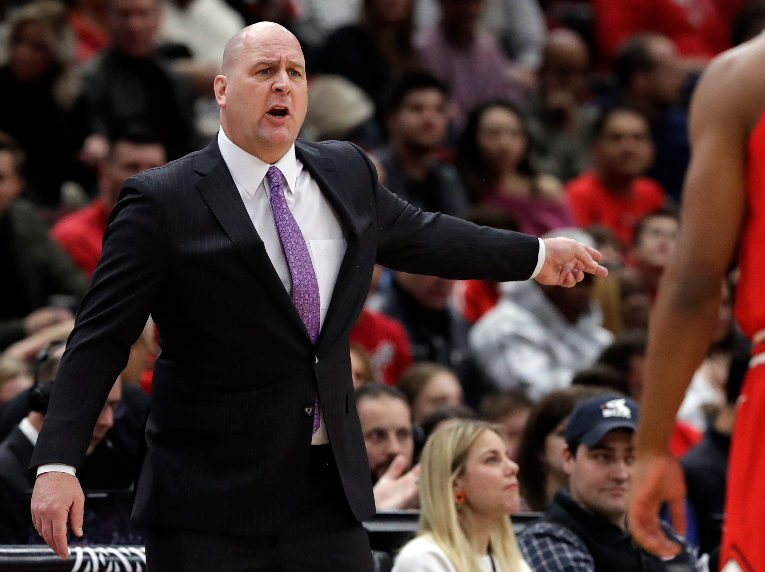 Chicago Bulls coach Jim Boylen stands near the bench during the first half of the team's NBA basketball game against the Detroit Pistons, Friday, March 8, 2019, in Chicago.
