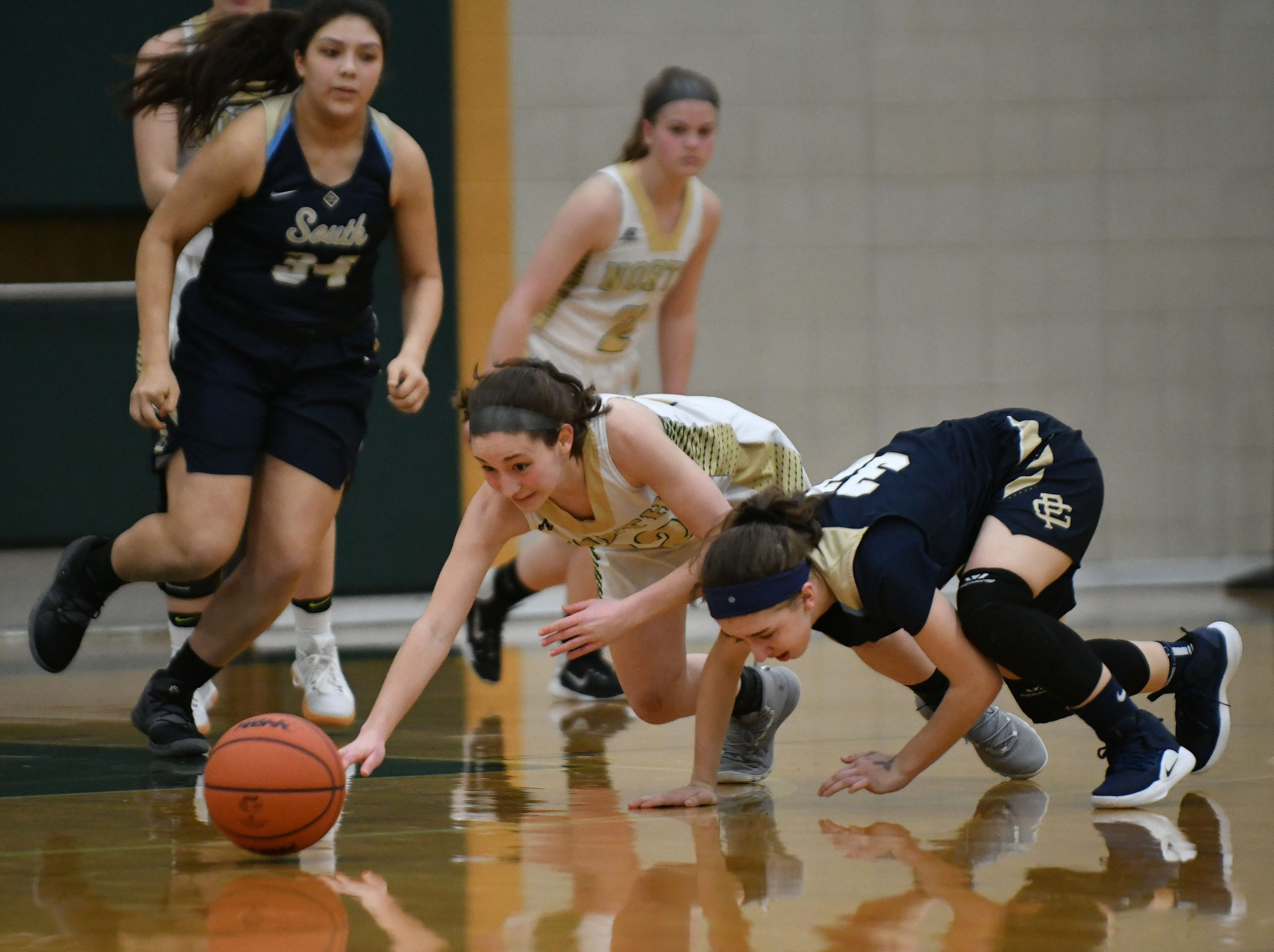 North's Hannah Davis (left) and South's Kamryn Richards go after a loose ball in the second half.