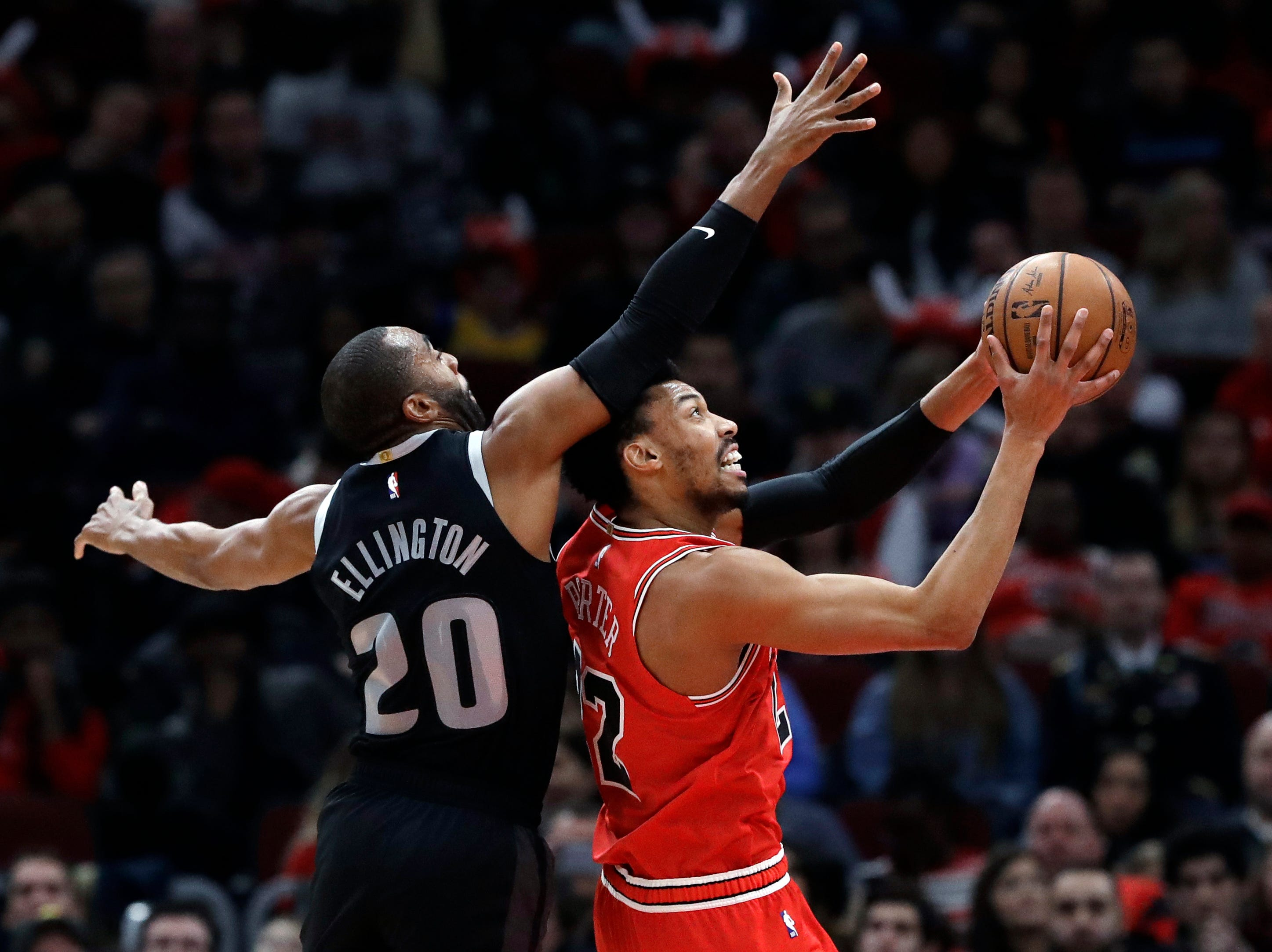 Chicago Bulls forward Otto Porter Jr., right, shoots as Detroit Pistons guard Wayne Ellington guards during the first half of an NBA basketball game.