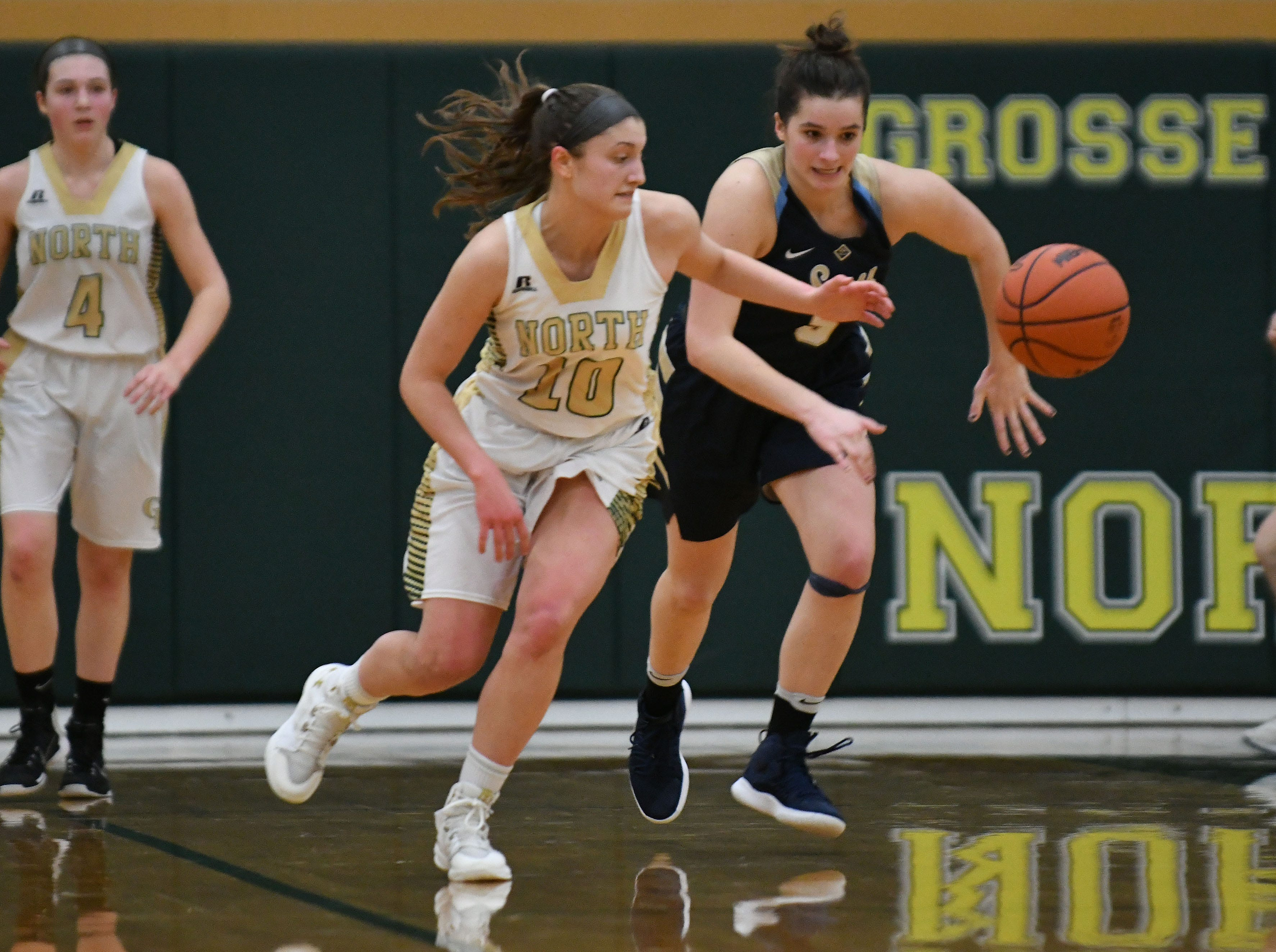 North's Evelyn Zacharias knocks away a pass intended for South's Savannah Srebernak during the second half.