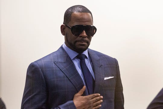 Musician R. Kelly arrives at the Daley Center for a hearing in his child support case at the Daley Center, Wednesday, March 6, 2019, in Chicago.