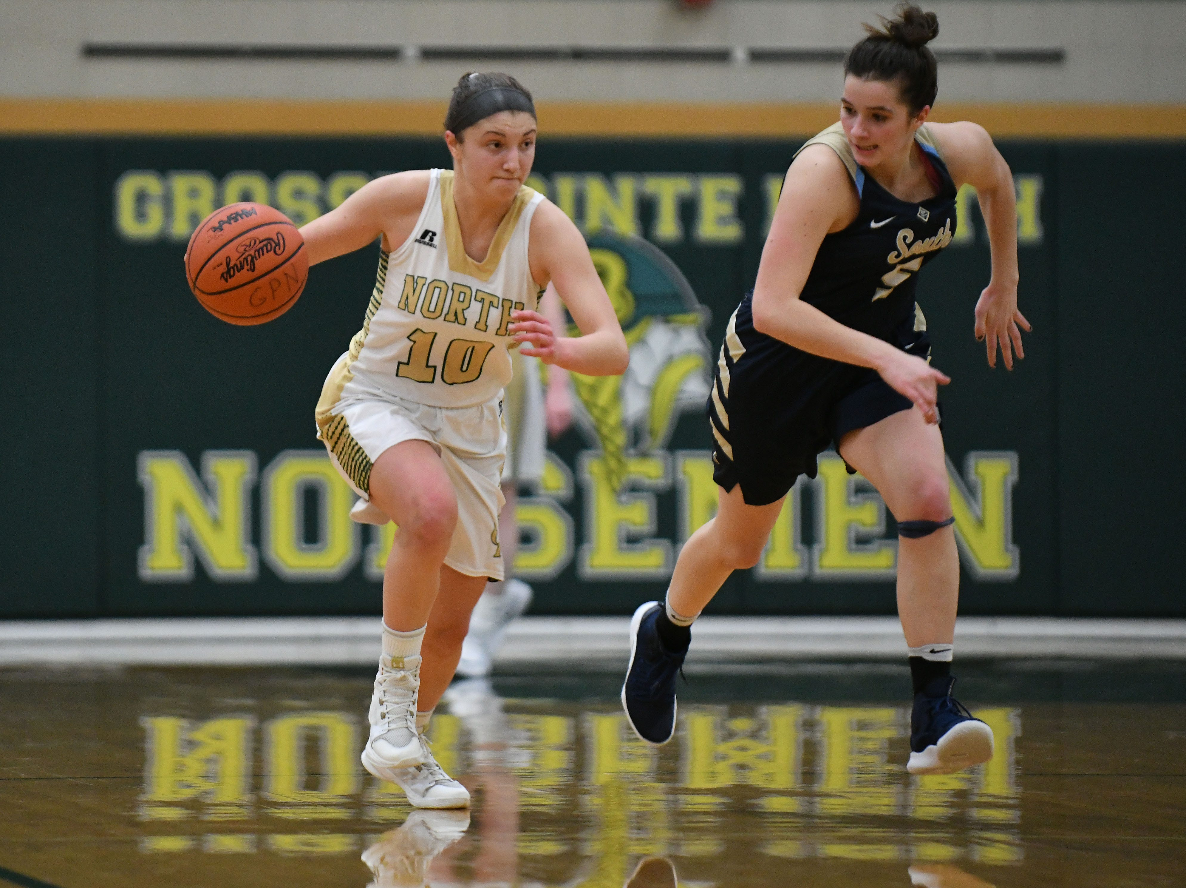 North's Evelyn Zacharias dribbles up court with South's Savannah Srebernak on her heels during the second half.