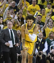 Michigan's Isaiah Livers celebrates a basket in the first half of last month's game against Michigan State.