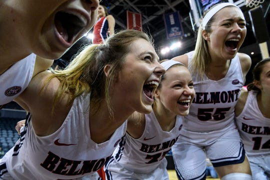 Belmont's Maura Muensterman (31) and her teammates huddle together before the start of the Ohio Valley Conference women's basketball championship against the University of Tennessee-Martin Skyhawks at Ford Center in Evansville, Ind., Saturday, March 9, 2019.