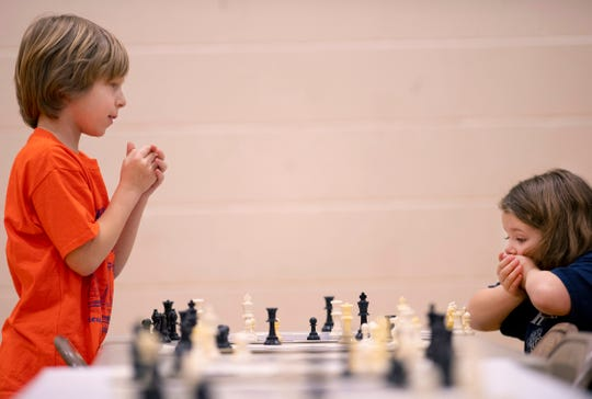 Cristian Diaz, 8, McCutchanville Elementary School, left, and Ana Schmitt, 7, Oak Hill Elementary School, wind up in a stalemate at the K-12 Spring Scholastic Chess Tournament at North Junior High School Saturday.