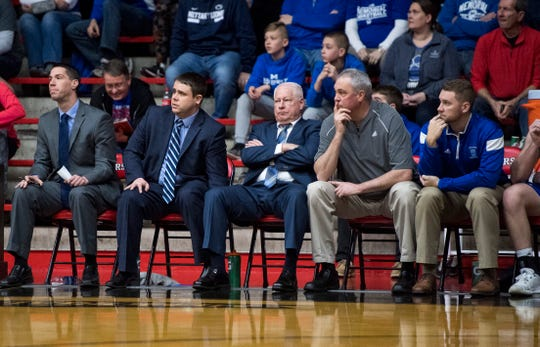 Memorial coach Rick Wilgus (middle) sits with arms crossed as the Tigers fell to No. 6 Silver Creek, 79-50, in the Class 3A Southridge Regional semifinals on Saturday.