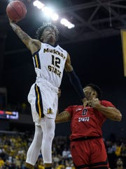 Murray State's Ja Morant (12) shoots over Jacksonville State's Jamall Gregory (0) during the Ohio Valley Conference tournament semifinals at Ford Center in Evansville, Ind., Friday, March 8, 2019. The Racers defeated the Gamecocks 76-74 to advance to the OVC Championship against the Belmont Bruins.