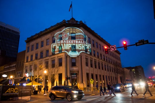 Ohio Valley Conference Tournament logo is projected on a building across from the Ford Center in Evansville, Ind., Friday, March 8, 2019.
