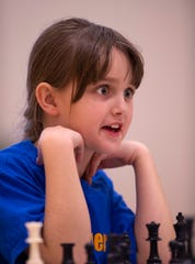 Alyssa Herrenbruck, 9, Scott Elementary School, competes in the K-12 Spring Scholastic Chess Tournament at North Junior High School Saturday.