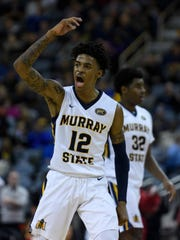 Murray State's Ja Morant (12) gestures to the crowd during the Ohio Valley Conference tournament semifinals against the Jacksonville State University Gamecocks at Ford Center in Evansville, Ind., Friday, March 8, 2019. The Racers defeated the Gamecocks 76-74 to advance to the OVC Championship against the Belmont Bruins.