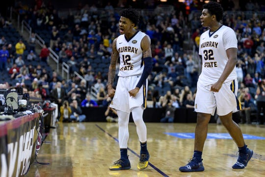 Murray State's Ja Morant (12) and Murray State's Darnell Cowart (32) hype up the crowd as they secure their lead over the Jacksonville State Gamecocks during the Ohio Valley Conference tournament semifinals at Ford Center in Evansville, Ind., Friday, March 8, 2019. The Racers defeated the Gamecocks 76-74 to advance to the OVC Championship against the Belmont Bruins.