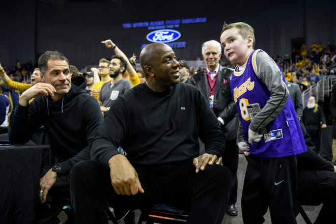 "Earvin ""Magic"" Johnson, former Los Angeles Lakers' player and current president of operations of the team, talks to Sam Schulz while sitting court-side during the Murray State Racers versus Jacksonville State Gamecocks semifinal match up at the Ohio Valley Conference tournament held at Ford Center in Evansville, Ind., Friday, March 8, 2019."