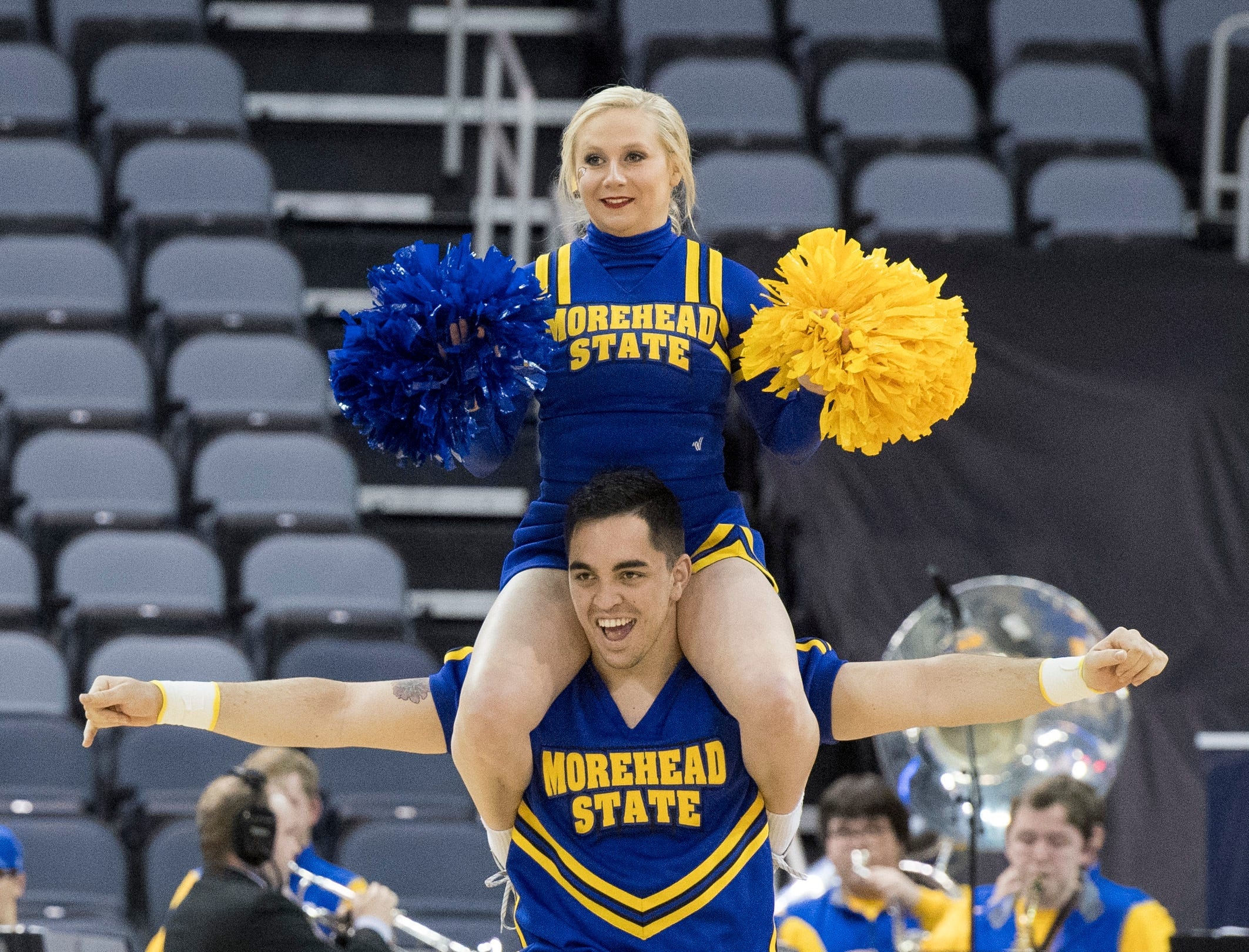 Morehead State Eagles cheerleaders Jennifer Creech and Jona Marrero dance during a time out of the Morehead State vs UT Martin game of the Ohio Valley Conference Tournament at the Ford Center in Evansville, Ind., Friday, March 8, 2019.