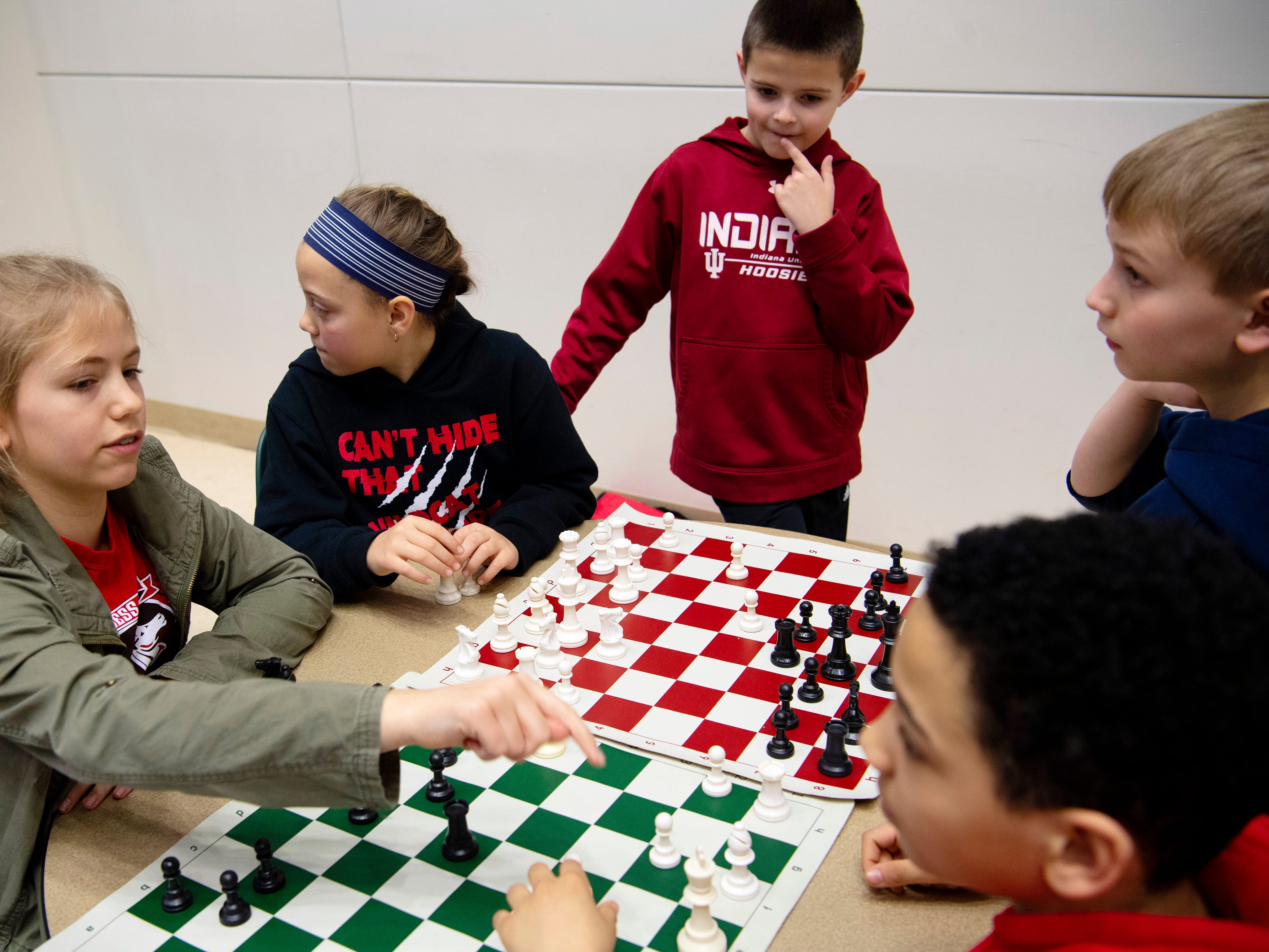 Speed chess keeps Cynthia Heights Elementary School students, from left, Reese Weinzapfel, Peyton Hensley, Leo Guetling, Donovan Moore and Grant Weinzapfel busy as they await their next matches in the K-12 Spring Scholastic Chess Tournament at North Junior High School Saturday.