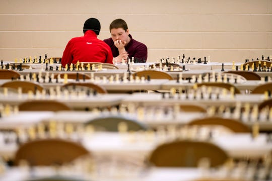 Henry Adams, 15, Mount Vernon High School, left, and Gary Richardson, 17, Central High School, compete in the K-12 Spring Scholastic Chess Tournament at North Junior High School Saturday.