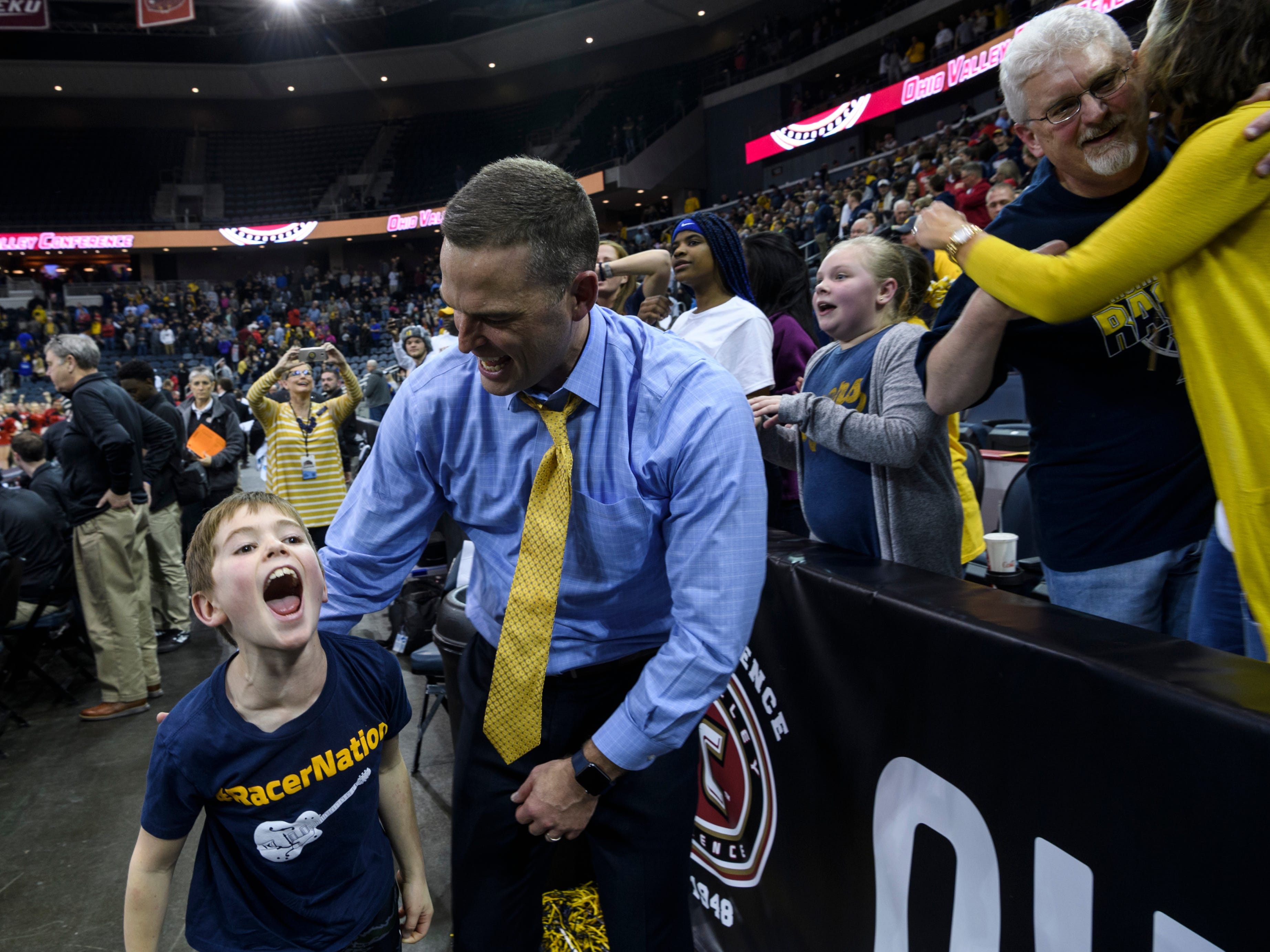 Mason McMahon, 7, celebrates the Murray State Racers 76-74 win with his father Matt McMahon, Racers Head Coach, during the Ohio Valley Conference tournament semifinals at Ford Center in Evansville, Ind., Friday, March 8, 2019. The Racers will advance to Saturday night's OVC Championship against the Belmont Bruins.