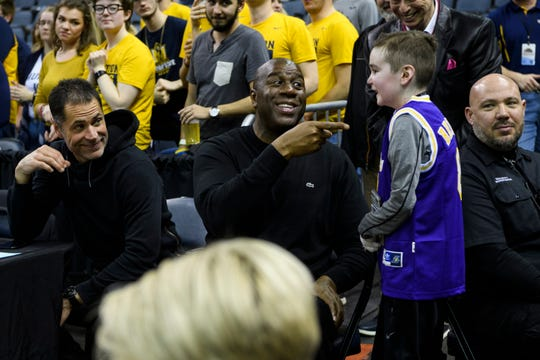 "Earvin ""Magic"" Johnson, former Los Angeles Lakers' player and current president of operations of the team, talks to Sam Schulz during the Murray State Racers versus Jacksonville State Gamecocks semifinal match up at the Ohio Valley Conference tournament held at Ford Center in Evansville, Ind., Friday, March 8, 2019."