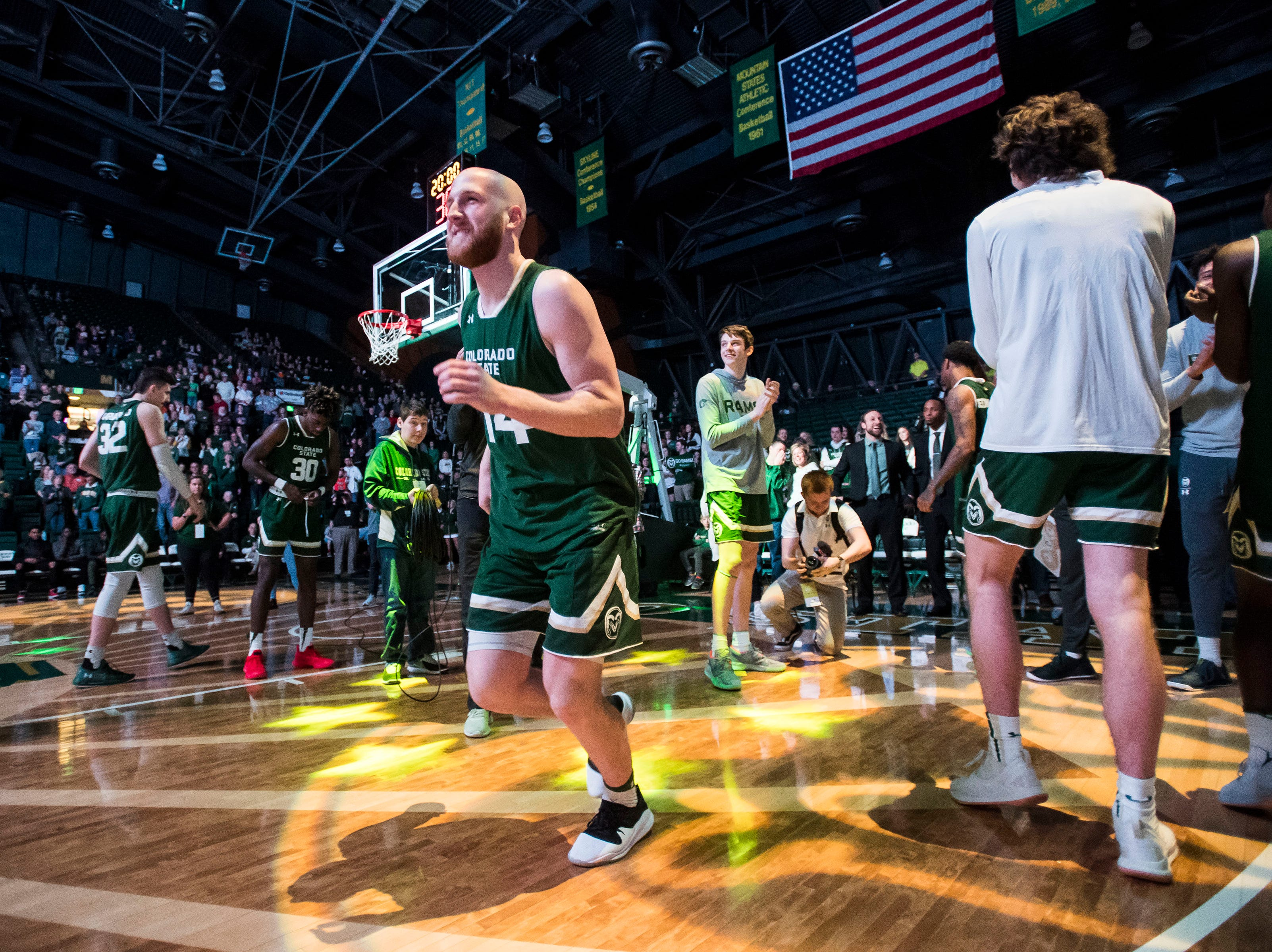 Colorado State University senior guar Robbie Berwick (14) is introduced before a game against University of Nevada, Las Vegas on Saturday, March 9, 2019, at Moby Arena in Fort Collins, Colo.