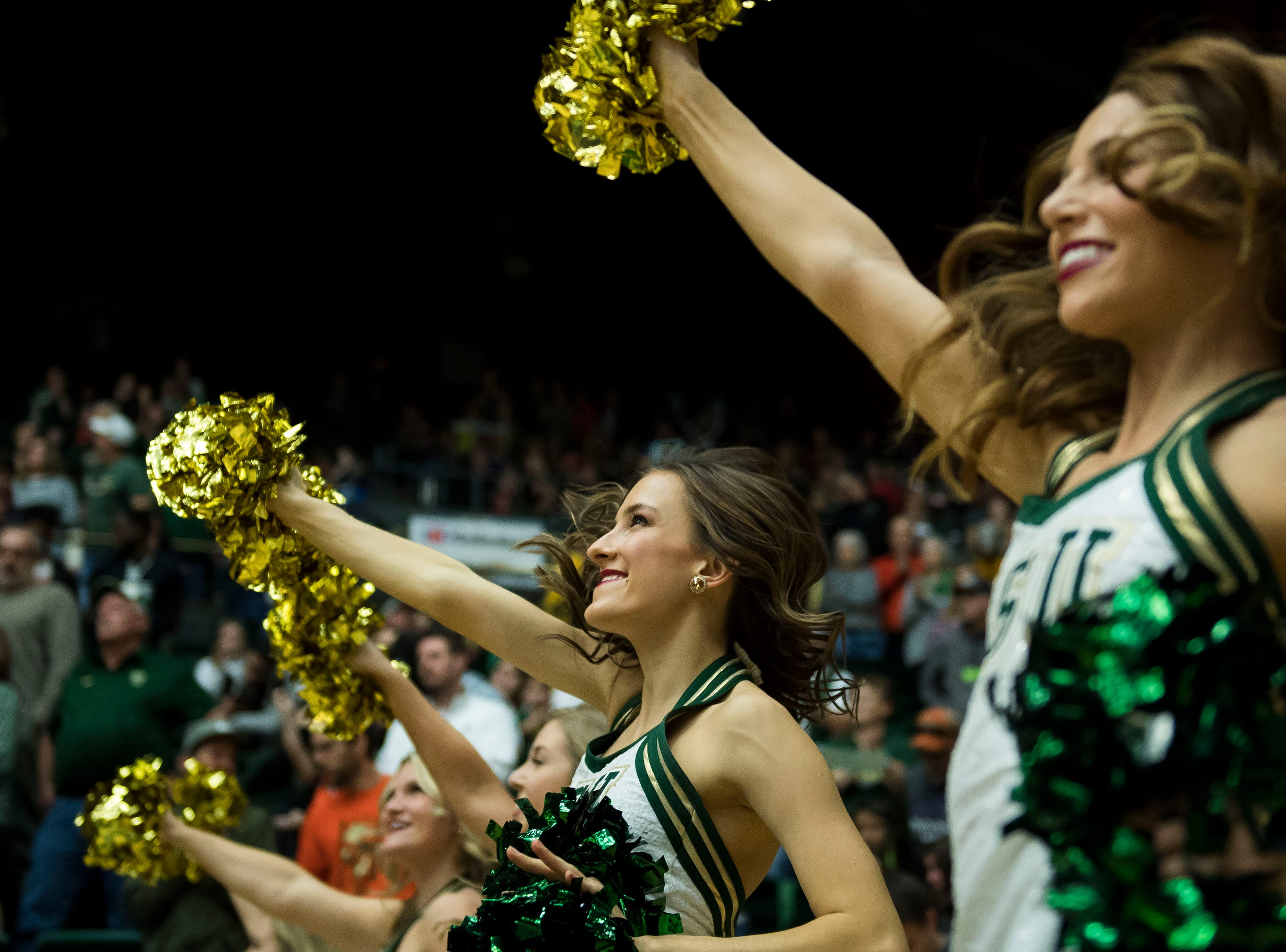 Colorado State University cheerleaders perform during a home game against University of Nevada, Las Vegas on Saturday, March 9, 2019, at Moby Arena in Fort Collins, Colo.